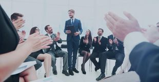 Business group greets leader with clapping and smiling Stock Image