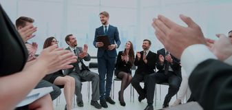 Business group greets leader with clapping and smiling Stock Images