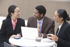 Business Group Having Discussion During Coffee Break Stock Photography