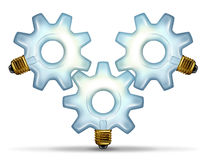 Business Group Ideas. With three illuminated glass light bulbs in the shape of a gear or cog connected together as a partnership team working for innovative Stock Images