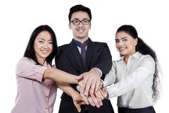 Business group joining hands Stock Images