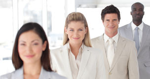 Business Group in a line with Differential focus Stock Photos