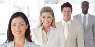 Business Group in a line with Differential focus royalty free stock photo