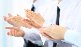 Business group of people clapping hands during a meeting. Happy business group of people clapping hands during a meeting Royalty Free Stock Image