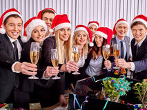 Business group people in santa hat drinking champagne  at Xmas. Happy business group people in santa hat drinking champagne  Xmas Royalty Free Stock Photography