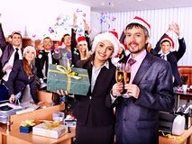 Business group people in santa hat at Xmas party. Happy business group people in santa hat at Xmas party Royalty Free Stock Image