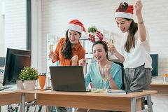 Business group people are sitting in Santa hats. Group of the young business group people are sitting in Santa hats in last working day and using computer laptop Royalty Free Stock Photo