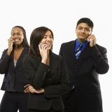 Business group on phones Royalty Free Stock Photography