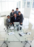 A business group showing diversity working. At a computer in the office Stock Photos