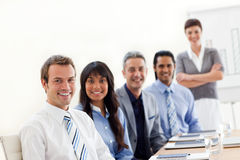 A business group showing ethnic diversity. At a presentation in the office Royalty Free Stock Photo