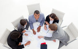 Business group sitting around a conference Stock Image