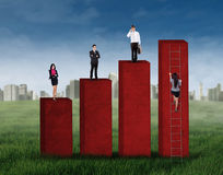 Business group standing on the graph Stock Photos