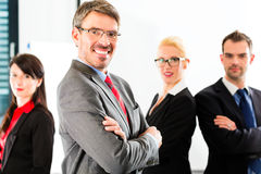 Business - group of businesspeople in office Stock Photography