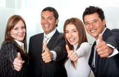 Business group with thumbs-up Stock Photos