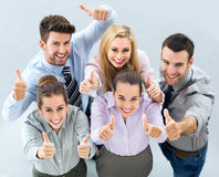 Business group with thumbs up. High angle of business people stock photography