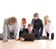 Business group at work. Business group of two young ladies, two young men and a mature boss at work. Image taken on a white background stock images