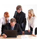 Business group at work. Business group of two young ladies, young man and a mature boss at work. Image taken on a white background royalty free stock photos