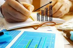 Business growing. Businessman analyze financial results. Business growing concept. Businessman analyze financial results stock photo