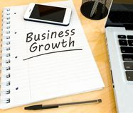 Business Growth. Handwritten text in a notebook on a desk - 3d render illustration Stock Photography