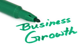 Business Growth written in white paper Royalty Free Stock Image