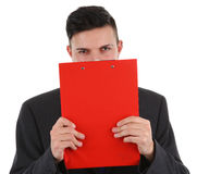 Business guy behind clipboard Stock Image