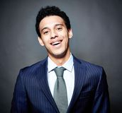 Business guy with braces. Portrait of a cheerful business guy with braces, against black background Stock Photography