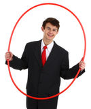 Business guy going through a hoop Royalty Free Stock Image