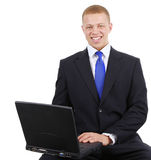 Business guy with laptop Stock Photography