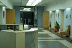 Business hall interior. With counter doors and armchairs Royalty Free Stock Photo