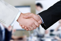 Business hand. Closeup of a business hand shake between two colleagues stock photo