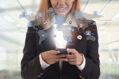 Business hand with application icons interface and globe network. Ing system. concept technology social network communication Royalty Free Stock Images