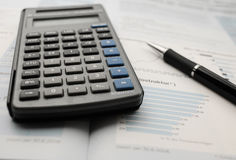 Business Hand Calculator. On a table Stock Photo