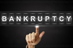 Business hand clicking bankruptcy on Flipboard Royalty Free Stock Photography