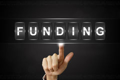 Business hand clicking funding on Flipboard stock photo