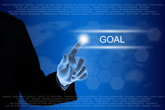 Business hand clicking goal button on touch screen Royalty Free Stock Photo