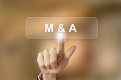 Business hand clicking merger and acquisition button on blurred stock images