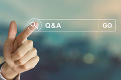 Business hand clicking Q&A or Question and Answer button on sear. Business hand clicking Q&A or Question and Answer button on search toolbar with vintage Stock Photography