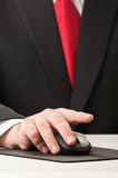 Business hand clicking wireless mouse Stock Photography