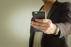 Business Hand. Close up businessman hold a smart mobile Stock Photography