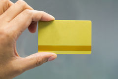 Business Hand. Close up hand hold a gold card Stock Photos