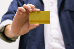 Business Hand. Close up a staff holding a gold card Royalty Free Stock Photos