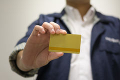 Business Hand. Close up a staff holding a gold card Royalty Free Stock Photo