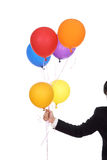 Business hand with colorful balloons Royalty Free Stock Photo