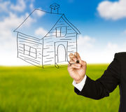 Business hand drawing a house Stock Image