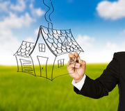 Business hand drawing a house Stock Photography