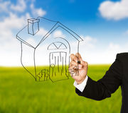 Business hand drawing a house Stock Images