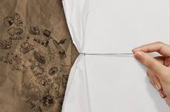Business hand draws rope open wrinkled paper. Show business strategy on recycle paper as concept Stock Images