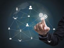 Business hand with gear icon networking system. Royalty Free Stock Photos