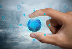 Business hand with globe icon networking system concept Royalty Free Stock Photography