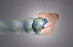 Business hand hold Earth. Royalty Free Stock Image